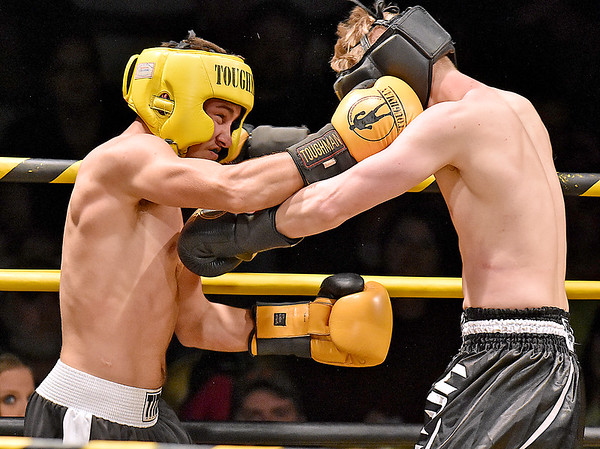 (Brad Davis/The Register-Herald) Itmann's R.J. Folden, left, connects with a right on opponent Kenneth Combs during the Original Toughman Contest Friday night at the Beckley-Raleigh County Convention Center. Folden would win the fight by T.K.O.