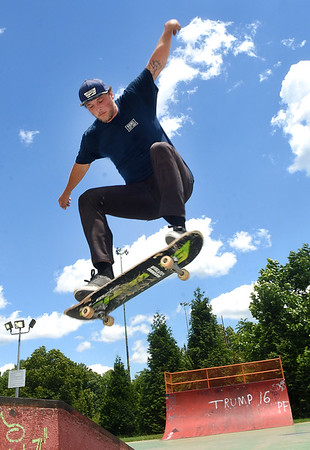 Devon Coffey, of Beckley goes airborne on his skateboard at Beckley Freedom Park on Eisenhower Drive. Coffey has been skateboarding for 12 years and does this for about three hours everyday with his friends.<br /> (Rick Barbero/The Register-Herald)