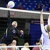 (Brad Davis/The Register-Herald) James Monroe's Kelsey Reed goes for a kill against Robert C. Byrd during State Volleyball Tournament action Friday afternoon at the Charleston Civic Center.