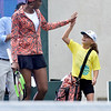 (Brad Davis/The Register-Herald) All-time tennis great Venus Williams high-fives young helper Eva Parks as she enters the stadium prior to her match against Martina Hingis during the Greenbrier Champions Tennis Classic Saturday afternoon in White Sulphur Springs.