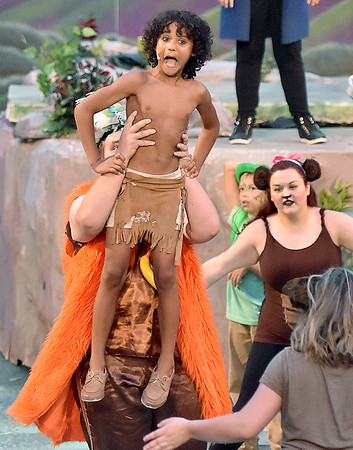 (Brad Davis/The Register-Herald) Mowgli, played by Jeremiah Allen, is pick up by King Louie, played by Zachary Glasscock, during a scene from Theatre West Virginia'a The Jungle Book Kids July 22 at Grandview Park's Cliffside Amphitheatre.