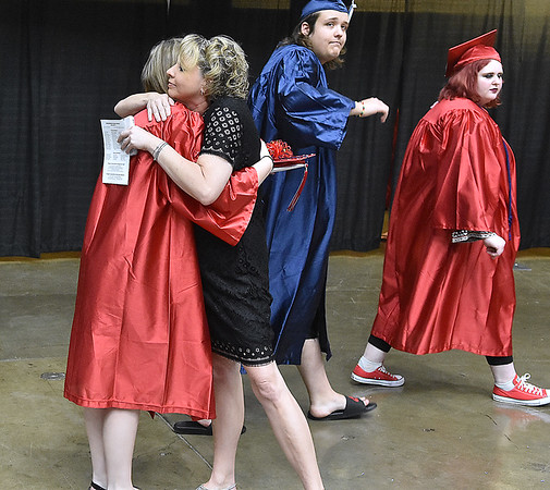 (Brad Davis/The Register-Herald) Independence teacher Milena Blankenship gets a few final hugs from her students as they exit the arena following Independence High School's 41st Commencement Saturday morning at the Beckley-Raleigh County Convention Center.