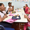 (Brad Davis/The Register-Herald) Beckley resident Iesha Watson, left, spends some time at lunch with her 6-year-old daughter and 1st grader Myava during a special Soul Food Luncheon Friday morning at Stratton Elementary School. Parents and guardians were invited to visit and sit down for a hot meal and some quality time with their hard-working kids and to check out all the students' special Black History Month projects, which hung on display through the cafeteria.