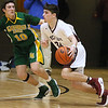 (Brad Davis/The Register-Herald) Woodrow Wilson's Bryce Radford moves along the perimeter as Greenbrier East's Corey Beswick defends during the Flying Eagles' Sectional Championship victory over the Spartans Friday night at the Beckley-Raleigh County Convention Center.