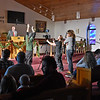 (Brad Davis/The Register-Herald) The scene from the pews as JCFilms crew members film scenes for a movie adapted to local author Eleanor Wright's book entitled Megan's Christmas Miracle inside Hollywood Missionary Baptist Church Saturday evening. A handful scenes in the movie will feature several local residents as extras.