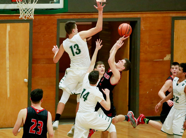 Fayetteville's Will Fenton (13) defends a shot by a Webster County player during their game Tuesday at the Soldiers & Sailors Memorial Building in Fayetteville. (Chris Jackson/The Register-Herald)