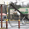 Power pole went down on East Main Street in Oak Hill  caused by a storm that hit the area.<br /> (Rick Barbero/The Register-Herald)
