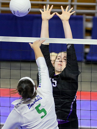 (Brad Davis/The Register-Herald) James Monroe's Whitney Hunt blocks a spike attempt against Robert C. Byrd during State Volleyball Tournament action Friday afternoon at the Charleston Civic Center.