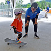 (Brad Davis/The Register-Herald) Two-year-old Anna Trim gets a skateboarding lesson from instructor Emma Tewawina during the Becthel Summit Reserve's Veteran's Appreciation day Saturday.