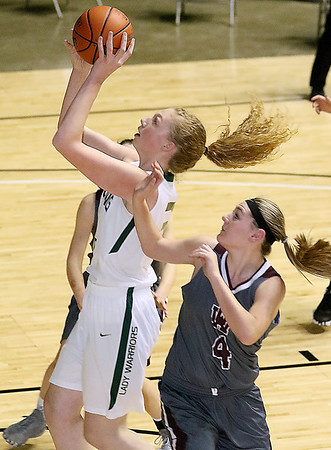 (Brad Davis/The Register-Herald) Wyoming East's Emily Saunders drives to the basket as George Washington's Lauren Harmison defends during Big Atlantic Classic action Wednesday night at the Beckley-Raleigh County Convention Center.