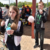 (Brad Davis/The Register-Herald) Ainsley McGlothlin (left), 15, chills out with an icee while younger brother Nick, 13, chomps down on some cotton candy during the annual Sweet Treats event Saturday afternoon atop Beckley's Intermodal Gateway.