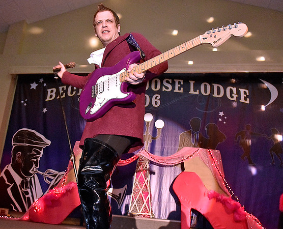 (Brad Davis/The Register-Herald) Jason Lockart during individual introductions at the annual Hunks in Heels fundraising event for the Women's Resource Center Friday night at the Beckley Moose Lodge.