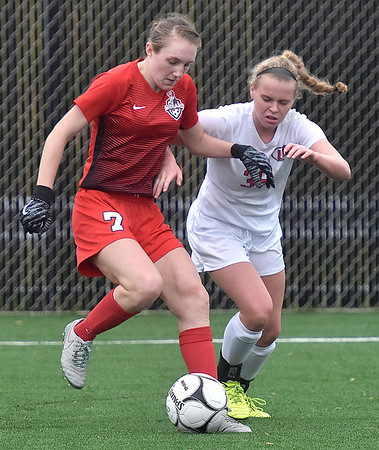 (Brad Davis/The Register-Herald) Cabell Midland's Emilie Charles, left, holds off University defender Valerie Brunner during the Class AAA Girls State Soccer Championship Game Saturday afternoon at the YMCA Paul Cline Memorial Sports Complex.