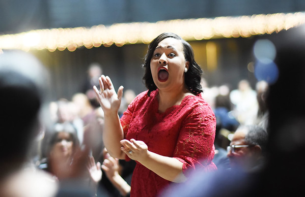 Jaleisa Coleman. choir conductor with the Heart of God Ministries Choir, leads the group during a performance as part of the Spirt of Beckley Awards at the Beckley-Raleigh County Convention Center in Beckley on Monday.  Bishop Fred T. Simms was awarded the annual award. (Chris Jackson/The Register-Herald)