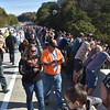 (Brad Davis/The Register-Herald) Spectators look for spots to watch the jumpers along the rail of the New River Gorge Bridge Saturday.