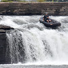 (Brad Davis/The Register-Herald) A buddy films at left as a rafter navigates his way down a small waterfall during Kanawaha Falls Fest Thursday morning in Gauley Bridge. The event was sponsored by ACE Adventure Gear and featured a whitewater kayak race, freestyle kayaking and even a photography contest open to spectators.