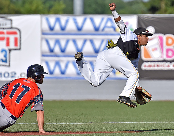 (Brad Davis/The Register-Herald) Miners shortstop Edwin Bonilla forces out and leaps over Chillicothe's Dalton Bollinger as he makes the throw for the first out of a 4-6-3 double play Sunday afternoon at Linda K. Epling Stadium.
