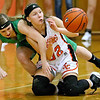 (Brad Davis/The Register-Herald) Summers County's Whittney Justice just gets a pass away to a teammate as she and Fayetteville's Mallory Hendrick scramble for a loose ball during the Lady Bobcats' Region Three championship win over the Pirates Thursday night in Hinton.
