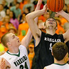 (Brad Davis/The Register-Herald) Westside's Corey Hatfield, right, tries to score off a rebound as Wyoming East's Zachary Cook defends during the second boys meeting of the year in the battle for Wyoming County Friday night in New Richmond.