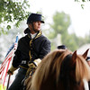 Civil War re-enactor Amy Maloney, from Rock Camp, on her horse after capturing the local Home Guard during a  battle between the local Home Guard and the Federal Army as part of Monroe County Heritage Day in Union on Saturday.  (Chris Jackson/The Register-Herald)