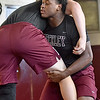 (Brad Davis/The Register-Herald) Woodrow Wilson senior Tyree Swafford works on moves as he grapples with teammate Colton Wright (220-pound weight class) during practice Wednesday afternoon.