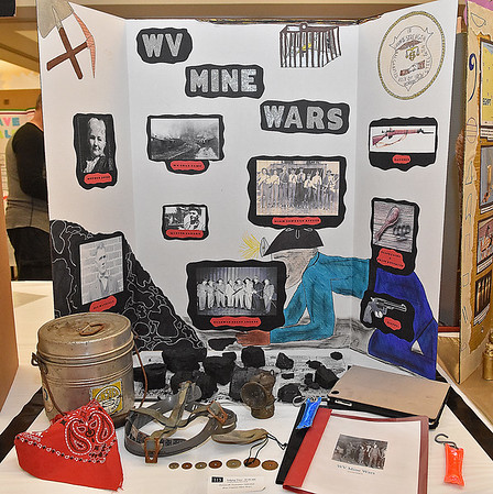 (Brad Davis/The Register-Herald) A project on the forgotten history of West Virginia's mine wars sits on display during the R.E.S.A. 1 Regional Social Studies Fair Saturday morning at the Beckley-Raleigh County Convention Center. Students from Monroe, McDowell, Raleigh, Summers and Wyoming Counties presented 191 projects with awards going out in nine different categories over three grade divisions (3rd-5th, 6th-8th and 9th-12th).