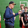 (Brad Davis/The Register-Herald) Houston Astros pitching coach Brent Strom demonsrates a few major league tips to participants of a special pitcher's clinic at the Upper Deck Baseball and Softball Academy Saturday afternoon.
