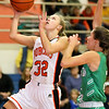 (Brad Davis/The Register-Herald) Summers County's Whittney Justice drives and scores as Charleston Catholic's Jordan Keener defends during the Lady Bobcats' win over the Irish Saturday night in Hinton.