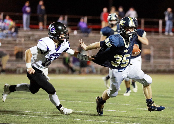 Nicholas County running back Jacob O'Dell (35) tries to break a tackle from James Monroe's Monroe Mohler (12) during their high school football game Friday in Summersville. (Chris Jackson/The Register-Herald)