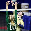(Brad Davis/The Register-Herald) Greenbrier West's Brittany Bevins sends the ball across as East Hardy's Abby Wilson tries to block it during State Volleyball Tournament action Friday morning at the Charleston Civic Center.