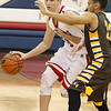 (Brad Davis/The Register-Herald) Independence's Tyler Haga moves the ball up the court as Mount View's Sidney George defends during the Patriots' win over the Golden Knights Saturday night in Coal City.