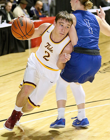 (Brad Davis/The Register-Herald) Sherman's Will Hensley drives around Gilmer's Gunnar Haley defends during Big Atlantic Classic action Thursday night at the Beckley-Raleigh County Convention Center.