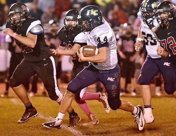 (Brad Davis/The Register-Herald) Nicholas County's D.J. McCutcheon runs through the PikeView defense for a big gain Friday night in Gardner.