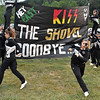 (Brad Davis/The Register-Herald) Westside cheerleader Ivory Stewart, lower right, scrambles with a teammate to get out of the way of the oncoming Renegade football team after holding the middle of their paper sign together in strong wind prior to the battle for Wyoming County Friday night in New Richmond.