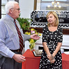 (Brad Davis/The Register-Herald) Mayor Rob Rappold shares some kind words and best wishes for outgoing United Way of Southern West Virginia executive director Magaret Ann O'Neal, right, during a special sendoff celebration for her at the organization's Croft Street location Friday afternoon.