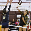 (Brad Davis/The Register-Herald) Greenbrier East's Maddie Cochran goes for a spike as Hedgesville's Ericka Link tries to block it during the Shirley Brown Invitational Volleyball Tournament Saturday afternoon at Woodrow Wilson High School.