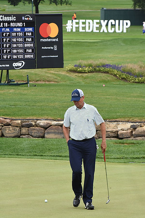 Davis Love lll looks over his putt the 18th hole during the first round of The Greenbrier Classic.<br /> (Rick Barbero/The Register-Herald.com
