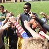 Rasheed Marshall, former MArshall football player, works with youth during a youth football camp held in Coal City.<br /> (Rick Barbero/The Register-Herald)