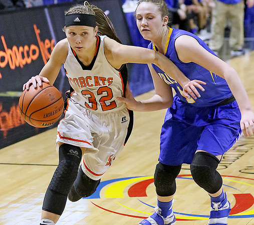 (Brad Davis/The Register-Herald) Summers County's Whittney Justice drives around St. Joseph Central's Bailee Adkins Friday afternoon at the Charleston Civic Center.
