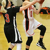 (Brad Davis/The Register-Herald) Summers County's Taylor Isaac scores on a layup as Chapmanville's Kara Browning defends during the Lady Bobcats' win over the Tigers Saturday night in Hinton.