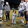 (Brad Davis/The Register-Herald) Two-year-old Clay Perdue gets a chance to do the pre-game coin toss Friday night in Clear Fork.