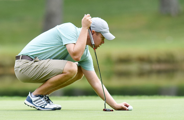 Brandon Reece gets his ball on the No. 11 green  during the championship round of the annual BNI Tournament Monday at The Resort at Glade Springs. (Chris Jackson/The Register-Herald)