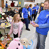 (Brad Davis/The Register-Herald) Six-year-old Kaitlyn Chipman shares a few laughs with volunteer Diania McMann as they check out stuffed animals during the Wyoming County Toy Fund Sunday morning at Wyoming East High School.