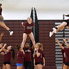 (Brad Davis/The Register-Herald) Woodrow Wilson cheerleaders run through one of their routines during practice at the school Wednesday afternoon as the squad prepares for an upcoming appearance at the state cheerleading championships.