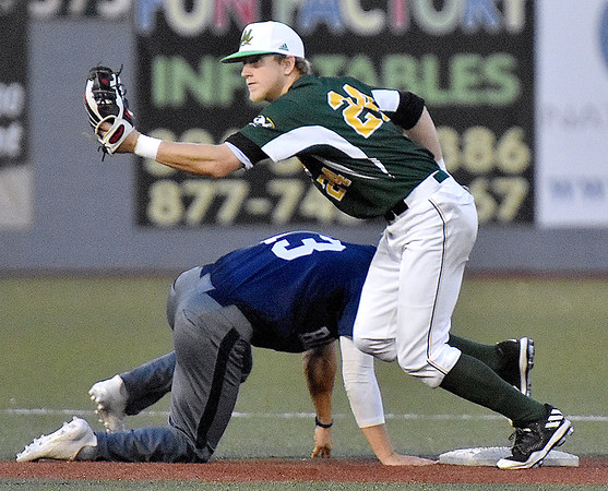 (Brad Davis/The Register-Herald) Miners 2nd baseman Kyle Bergeron holds up the ball and springs back to the dugout after catching Butler baserunner Pavin Parks snoozing and tagging him out on a pickoff throw from catcher Brent Todys to end the Blue Sox 6th inning Wednesday night at Linda K. Epling Stadium.