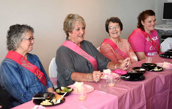 Mary Ann White, left, Teddie Sepkowski, Mancy Ward and Leslie Wooline, share their testimony about being a breast cancer survivor during a celebration held at Raleigh General Hospital Friday afternoon.<br /> (Rick Barbero/The Register-Herald)