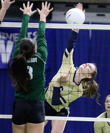 (Brad Davis/The Register-Herald) Greenbrier West's Kaitlin Mullens spikes the ball as East Hardy's Jessica Smith tries to block it during State Volleyball Tournament action Friday morning at the Charleston Civic Center.