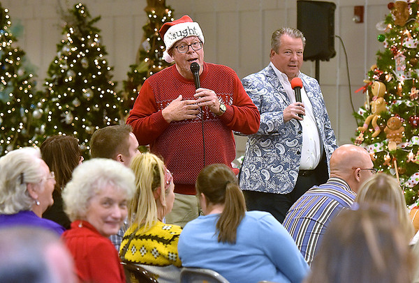 (Brad Davis/The Register-Herald) Auctioneers Scott Hill, left, and Richard Jarrell keep the crowd laughing and engaged as they solicit bids on the many themed Christmas trees available during the United Way of Southern West Virginia's annual Wonderland of Tree charity event Friday night inside the Crossroads' Mall.