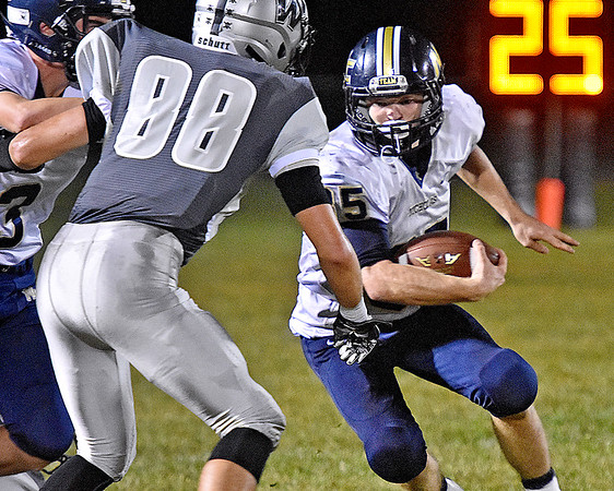 (Brad Davis/The Register-Herald) Nicholas County's Jacob O'Dell cuts to avoid Westside defender Cody Justus Friday night in Clear Fork.
