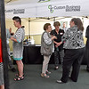 (Brad Davis/The Register-Herald) Area residents, business folks and local leaders mingle during this month's Chamber Business After Hours event at Custom Business Solutions off Ontario Drive in Mount Hope Thursday evening.